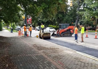 Park Ave STA. 16+60 – Asphalt overlay rolled into place over concrete cap of previously installed storm serwer (08/01/2018.